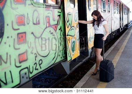 Young Businesswoman On A Business Travel. Getting On The Train.