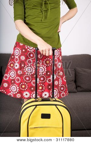 flowered skirt woman ready to travel