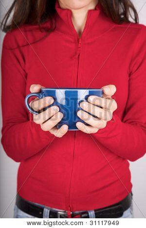 hands and blue mug