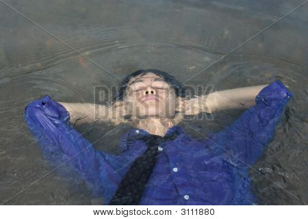 Business Man Putting Head In Water