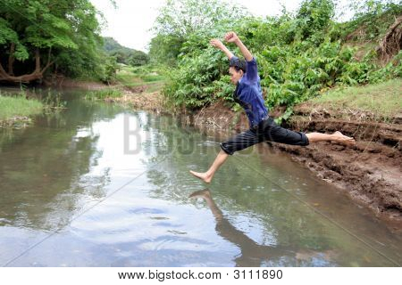 Man Jumping On River