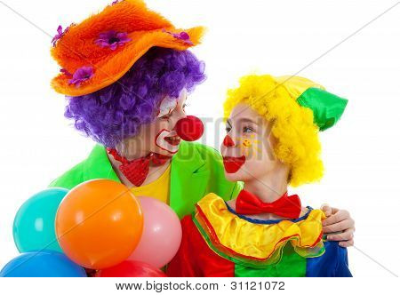 Two Children Dressed As Colorful Funny Clown With Balloons