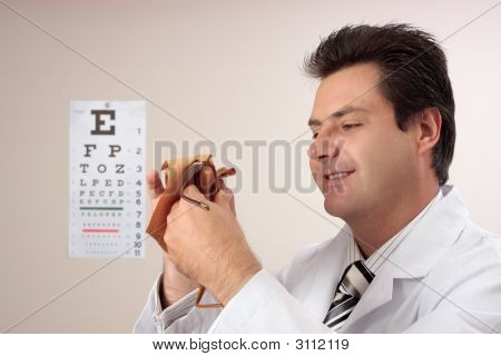 Optometrist Cleaning Glasses