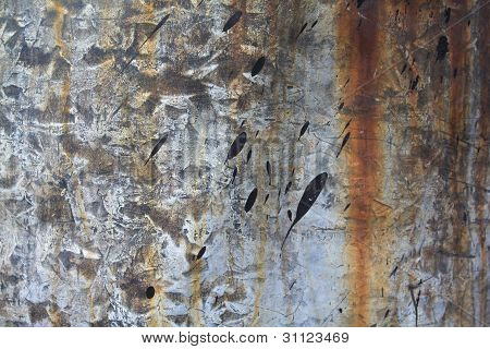 Rusty metal surface with colour splashes