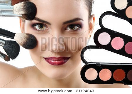beauty portrait of young beautiful woman with makeup brushes and palette of eye shadows isolated on white background