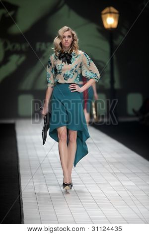 "ZAGREB, CROATIA - MARCH 17: Fashion model wears clothes made by Envy Room on ""Dove FASHION.HR"" show on March 17, 2012 in Zagreb, Croatia."