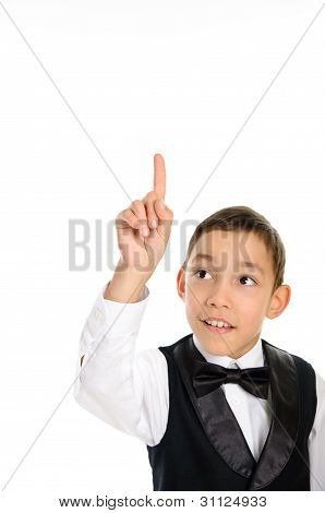 School Boy In Black Suit Touching Something With His Finger Isolated On White