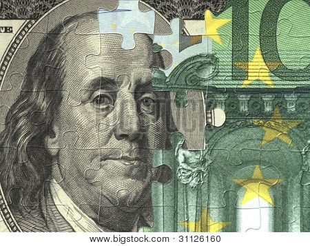Collected puzzle with the image of dollar and euro