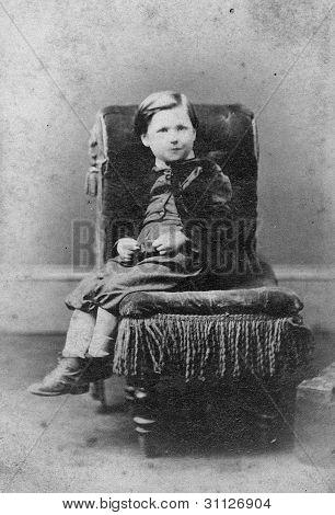 Portrait Of Boy On Chair