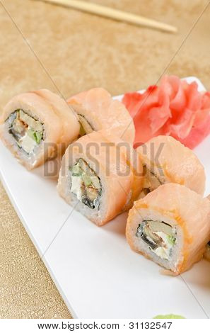 sushi roll of shrimp, eel, cucumber, pepper and sauce