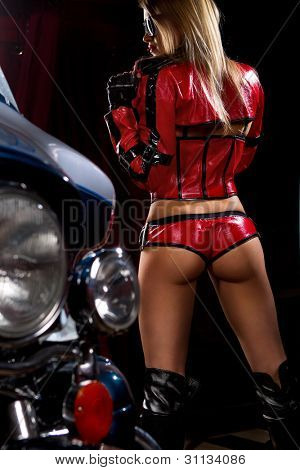 Fashion model wears red clothes with motorbike