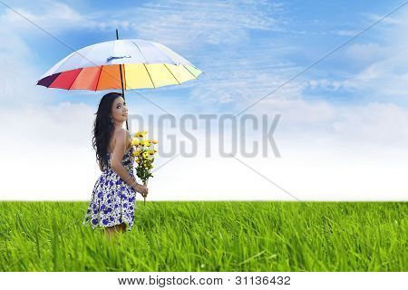 Beautiful Woman With Flowers And Umbrella
