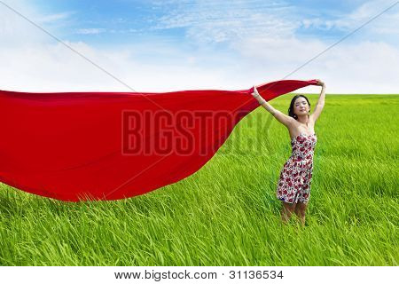 Carefree Woman With Red Scarf On Rice Field