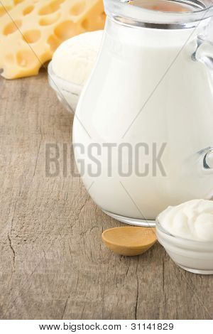 swiss cheese and milk products on wood background