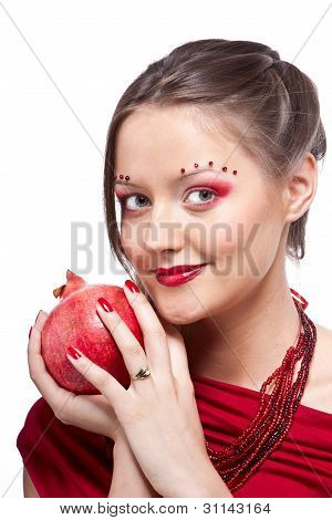 Portrait Of Young Beautiful Woman With Pomegranates In Her Hands, On White Background