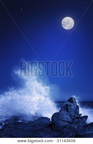 Rising moon over Rocky coastline at night  (Elements of this image furnished by NASA: moonmap  http://visibleearth.nasa.gov)