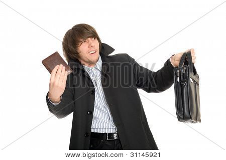 Panic frightened young man gives the personal belongings of the alleged robber.