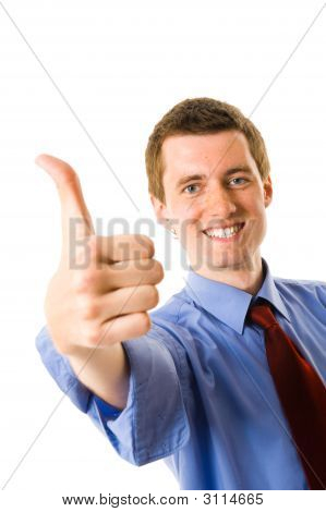 Young Businessman Showing Thumb Up And Smile. Sign