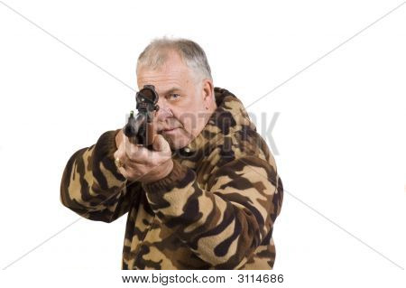 Hunter Shooting At Target With A Air-Rifle Pointed At Camera