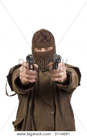 Masked Man With Two Semi-Automatic Pistols Pointed At The Camera