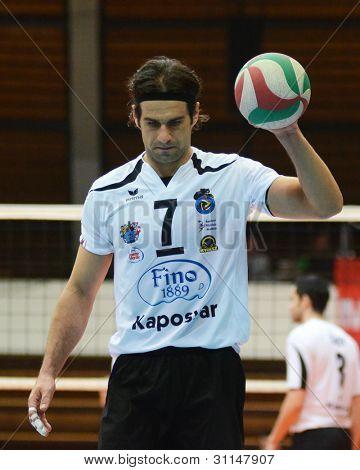 KAPOSVAR, HUNGARY - MARCH 16: Andras Geiger (white 7) in action at a Hungarian Championship volleyball game Kaposvar (white) vs. Kazincbarcika (blue), March 16, 2012 in Kaposvar, Hungary.