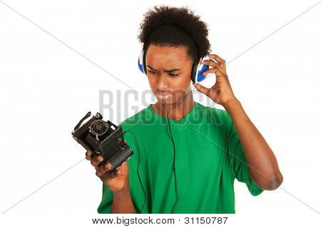 teenager boy is with headphones connecting to vintage photo camera