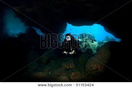 Diver In A Lava Tube In Kona Hawaii