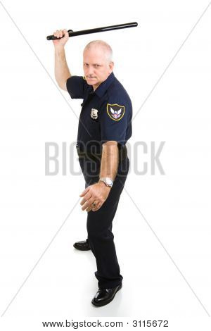 Policeman Using Night Stick