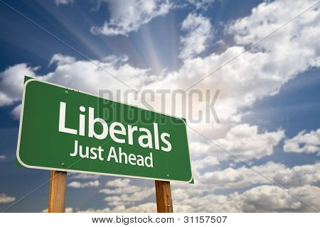 Liberals Green Road Sign with Dramatic Clouds, Sun Rays and Sky.