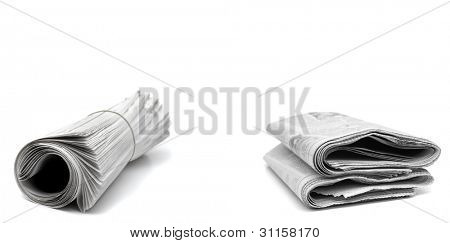 Rolled up newspapers isolated on white background