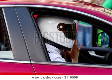 Anonymus driver in white helmet