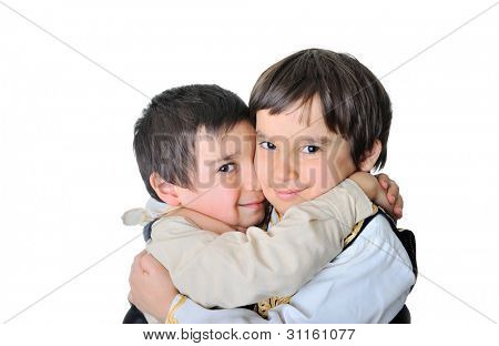 Little brothers hugging each other