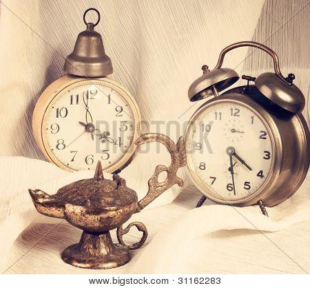 old style alarm clock's and aladdin magic lamp