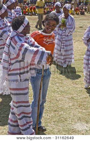 Young Ethiopian Men And Women Performing A Traditional African Dance