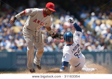 LOS ANGELES - JUNE 30: Dodgers C #55 Russell Martin (R) steals second by getting by Angels SS #2 Erick Aybar (L) during the Angels vs Dodgers game at Dodgers Stadium on June 30th 2010 in Los Angeles.