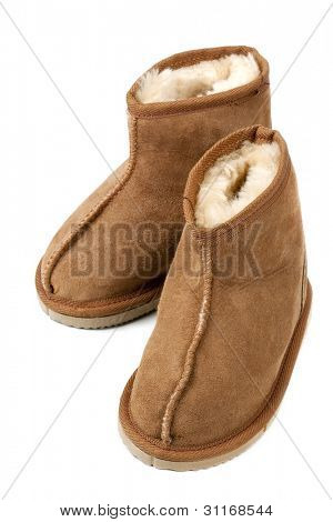 Pair of child size sheepskin boots, isolated on white.