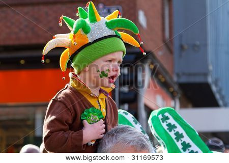 LIMERICK, IRELAND - MARCH 17: Unidentified child with an Irish hat participates in a parade for St. Patrick's Day,  traditional Irish holiday. March 17, 2012 in Limerick, Ireland.