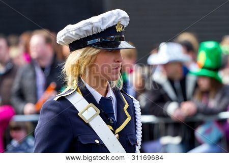 LIMERICK, IRELAND - MARCH 17: Unidentified woman participates in a parade for St. Patrick's Day. It's a traditional Irish holiday celebration. March 17, 2012 in Limerick, Ireland.