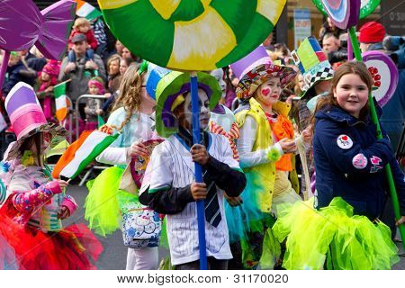 LIMERICK, IRELAND - MARCH 17: Unidentified children participate in a parade for St. Patrick's Day. It's a traditional Irish holiday celebration. March 17, 2012 in Limerick, Ireland.