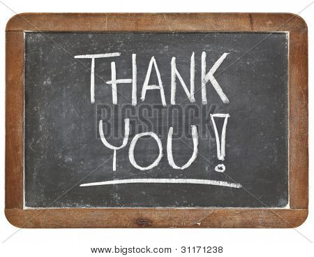 thank you - white chalk handwriting on vintage slate blackboard isolated on white
