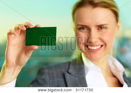Image of confident businesswoman showing blank visiting card in her hand