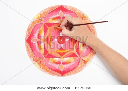 Man Hand Painting Abstract Red Picture With Circle Pattern, Mandala Of Muladhara Chakra