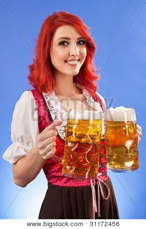 Beautiful Woman Serving Beer At Oktoberfest