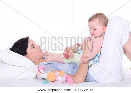 Young mother with adorable baby girl