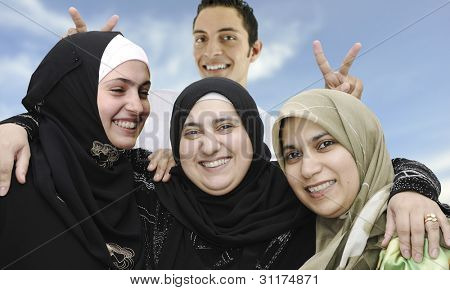 four arabic Muslim people, portrait together,with funny face