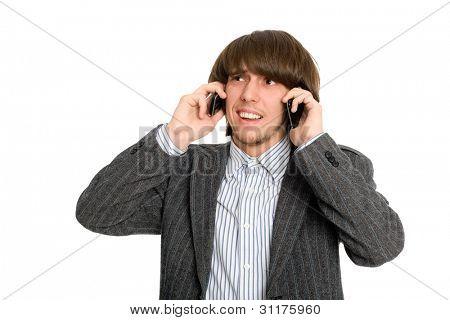 Emotional stockbroker talking on two mobile