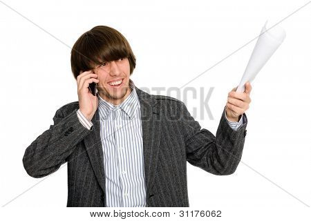 Young businessman talking on a mobile arm and points to the side.