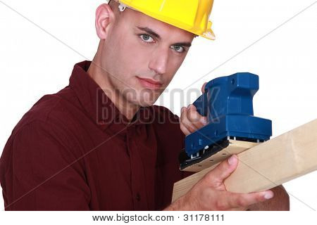 Man using electric sander
