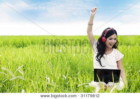 Beautiful Woman Enjoys The Summer Day
