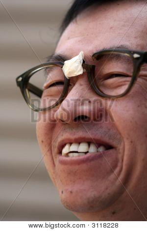 Asian Man Wearing Broken Glasses